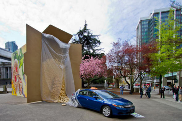 Honda Civic emerging from cereal  box. Photograph by Maurice Li.