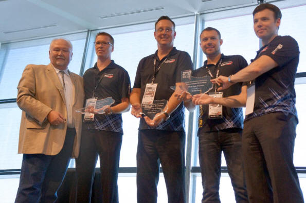 Michael Herzing President of TAWA presents three industry awards to Dodge executives.